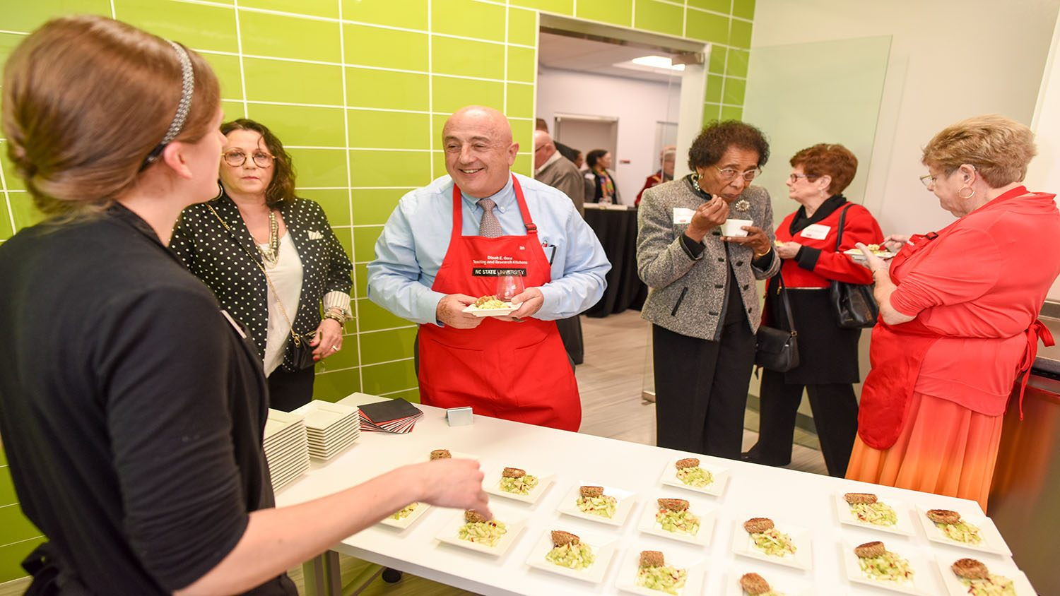 Dr. Bonnano taste testing at the Dinah Gore Kitchens Launch Event