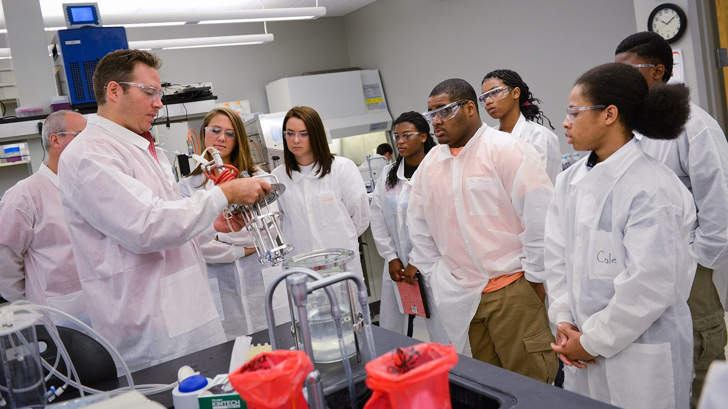 Scientist with students