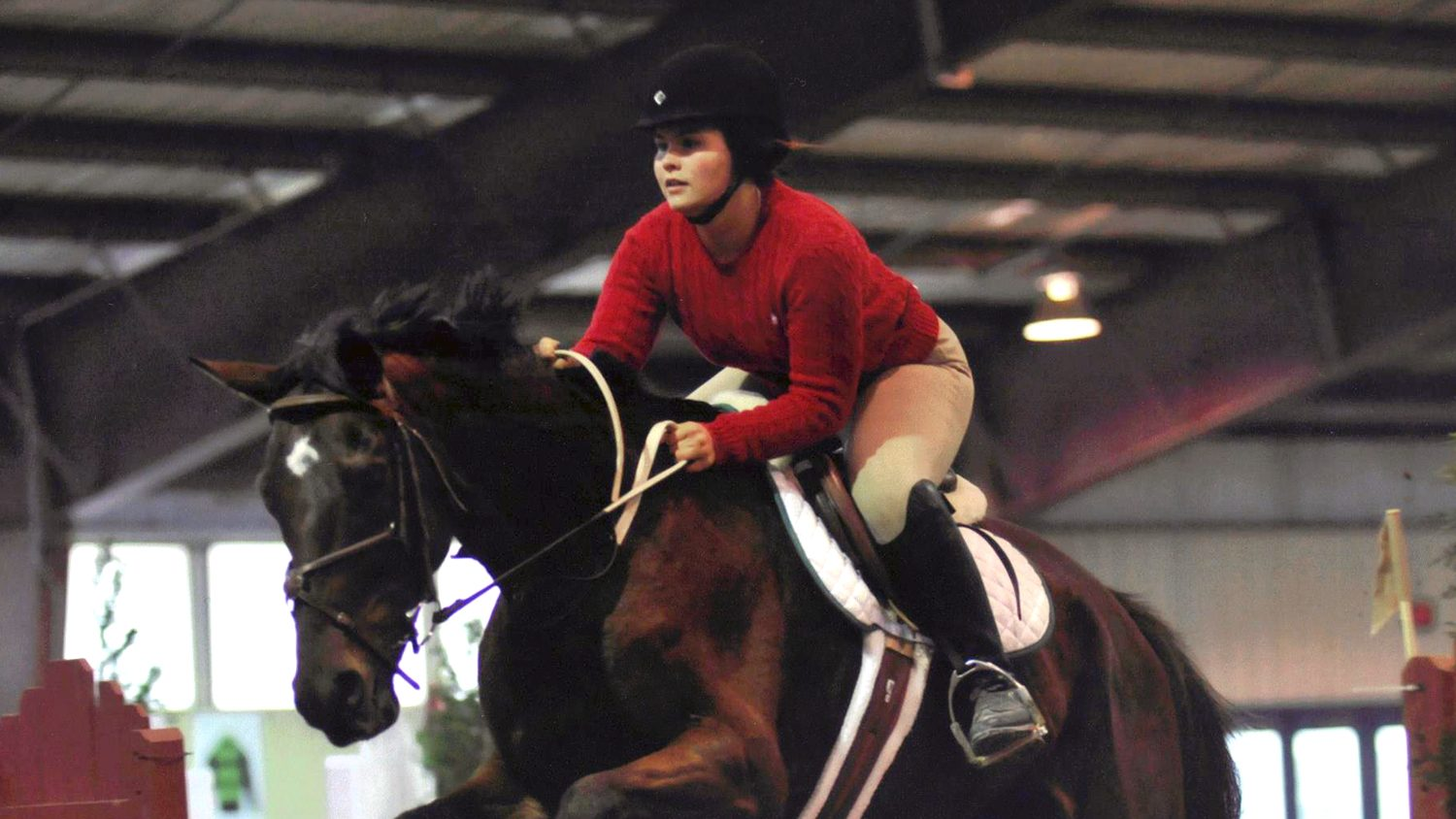 Student riding a horse in an equestrian competition