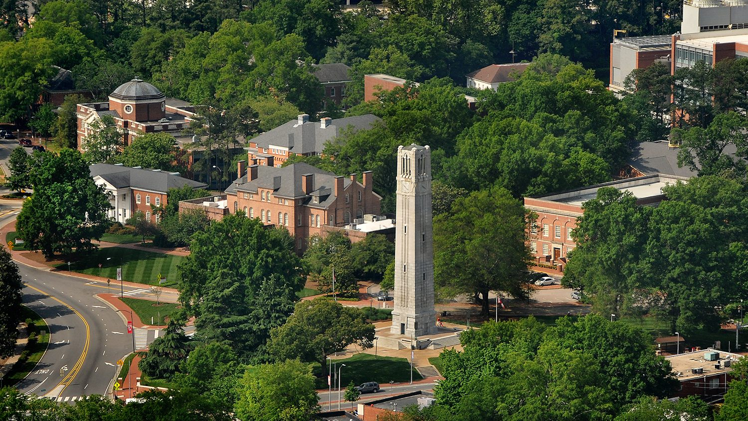 Aerial of Memorial Belltower and surrounding buildings on campus.
