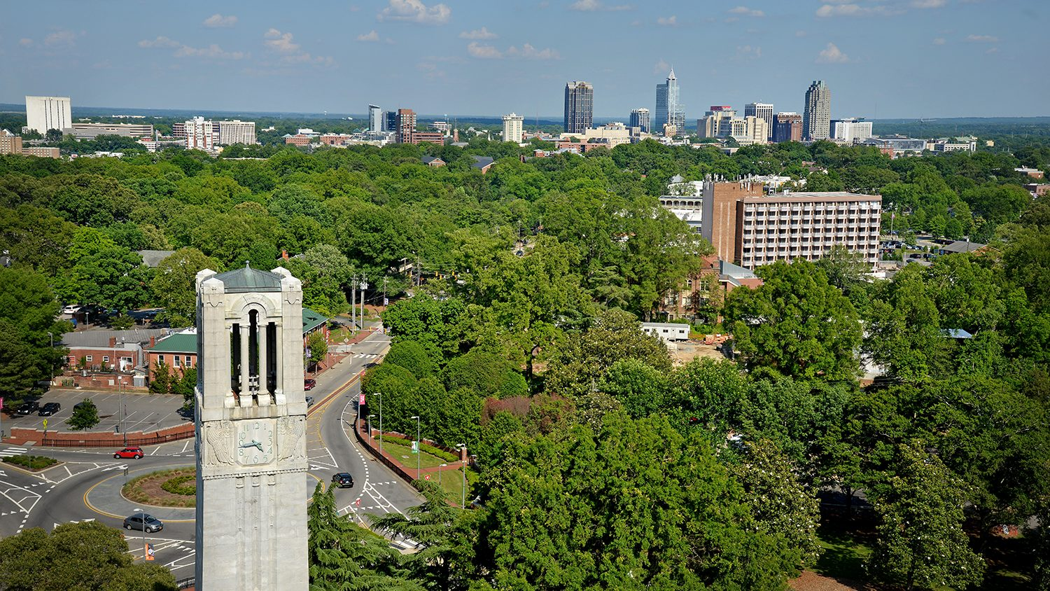 Aerial view of Belltower and downtown Raleigh to the east of campus.