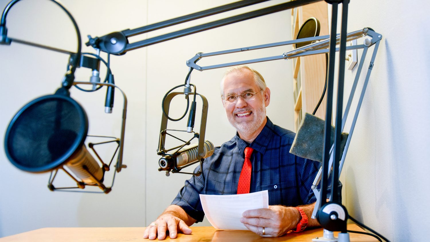 NC State College of Agriculture and Life Sciences professor Dr. Mike Walden working in a recording studio.