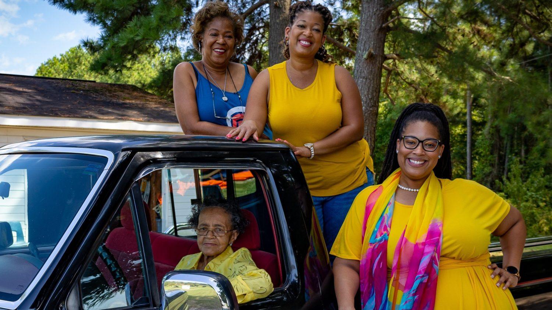 4 smiling women