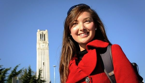 Students talk at the belltower on campus during Fall. Photo by Marc Hall