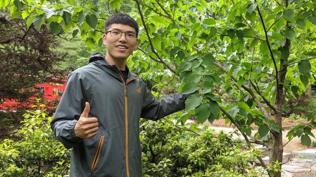 Scientist gives a thumbs-up during a visit to Duke's botanical garden.