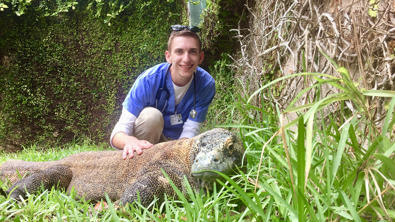 Animal Science student Christian Capobianco with a Komodo dragon.