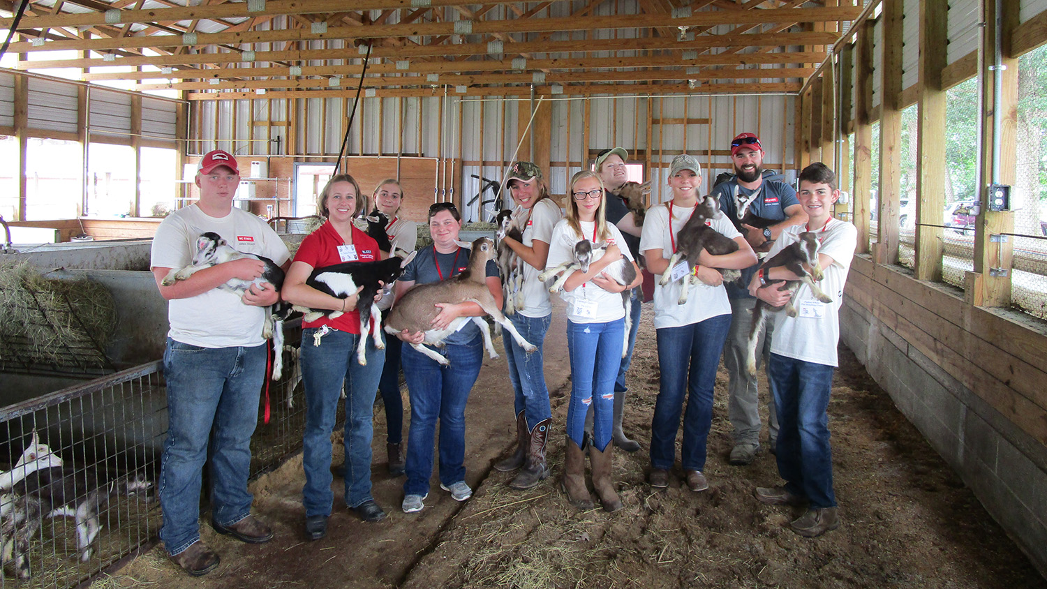 Participants of Livestock Science Camp holding animals.