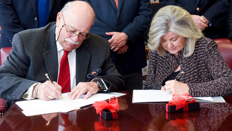 Frank and Judi Grainger sign endowment
