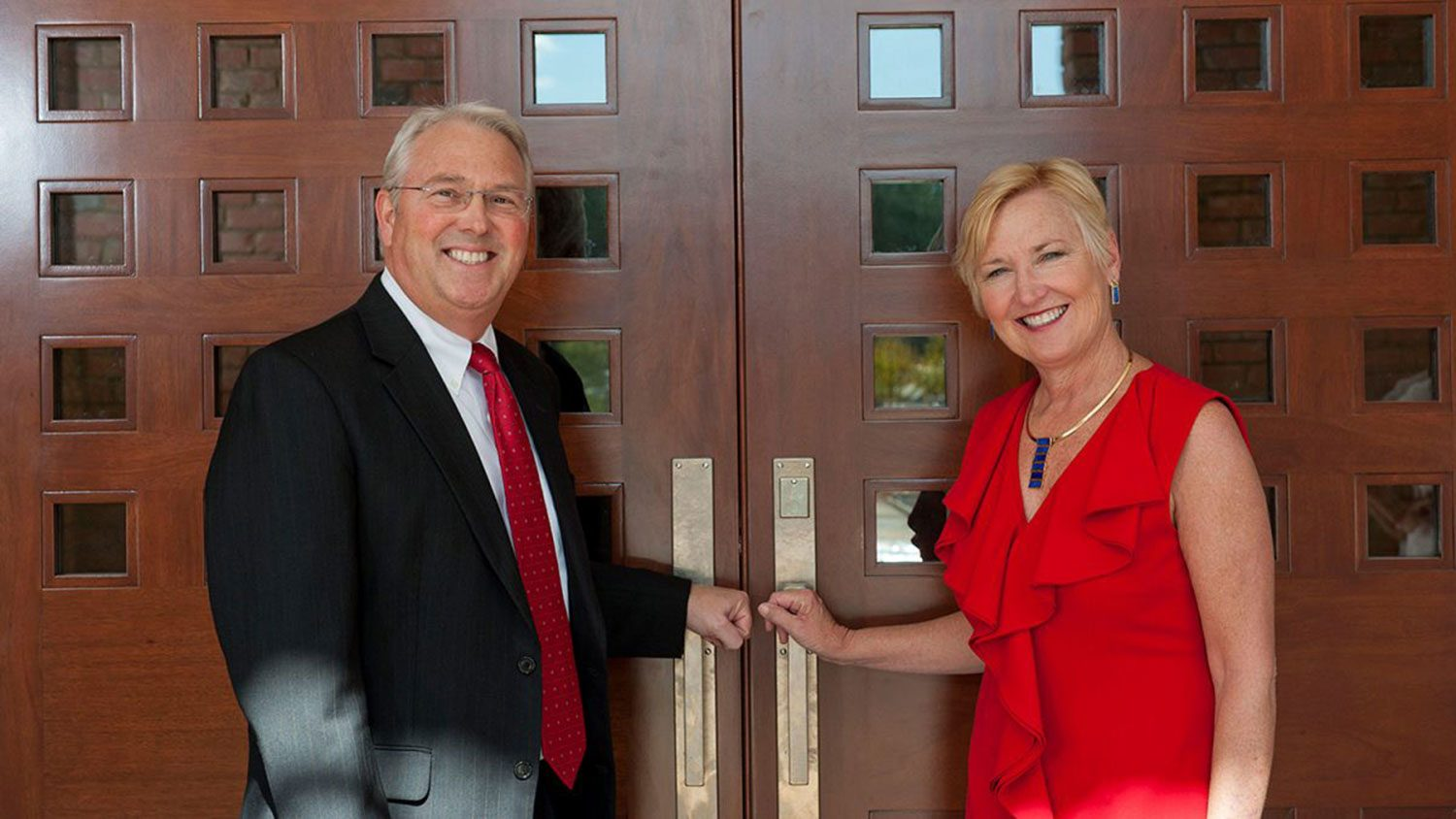 Randy and Susan Woodson at the front doors of The Point