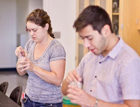 Dr. Erin McKenney and REU student mix sourdough starters for research