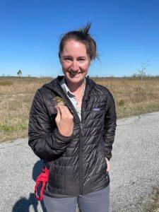 Emily Nastase with a sparrow.