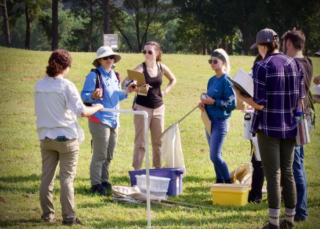 Erin McKenney with students during field ecology class