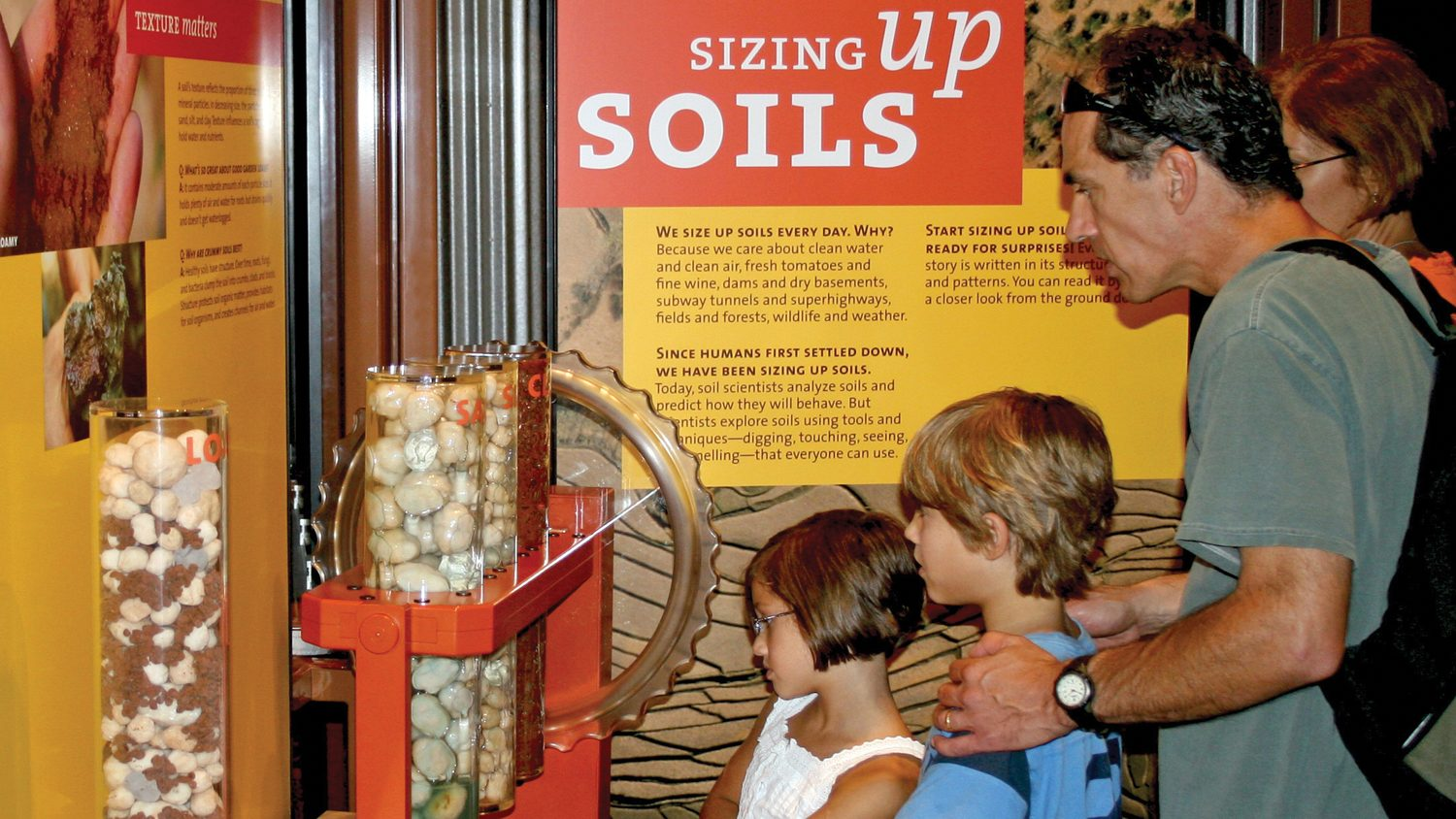 Children learning about soil at a museum