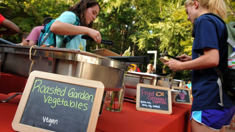 NC State students enjoying fresh vegetables grown on campus
