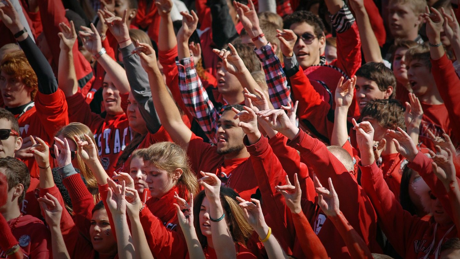 Students cheer on the Wolfpaack as they play UNC.