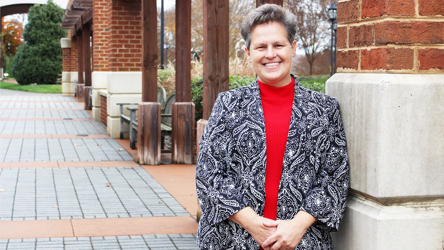 Paula Woodall in front of the State Club at NC State University