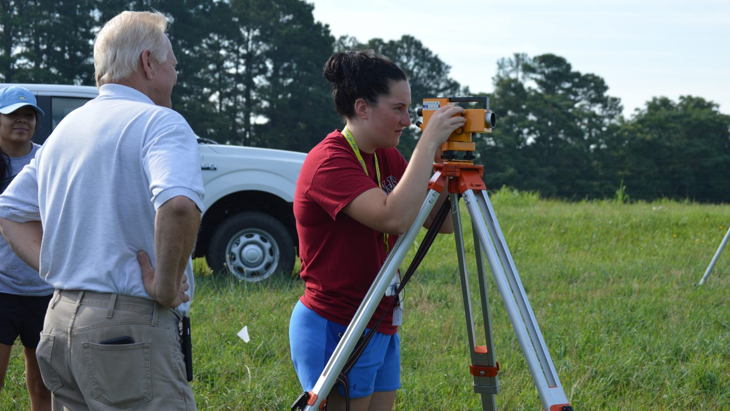 NC State RCW participant learns to use survey equipment