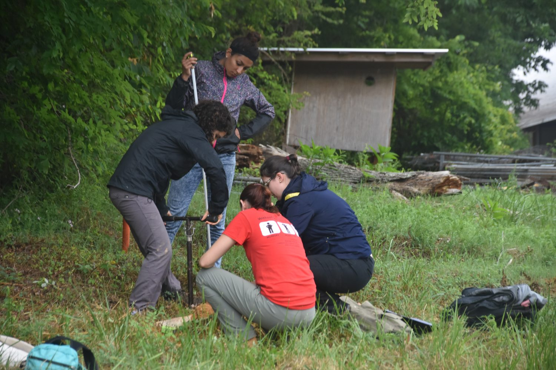 REU Students gets hands-on training in soil sampling