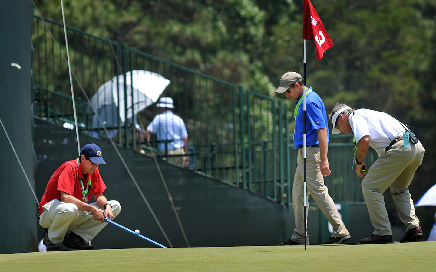 NC State alumni test greens at the Womens US Opens Gold Tournament