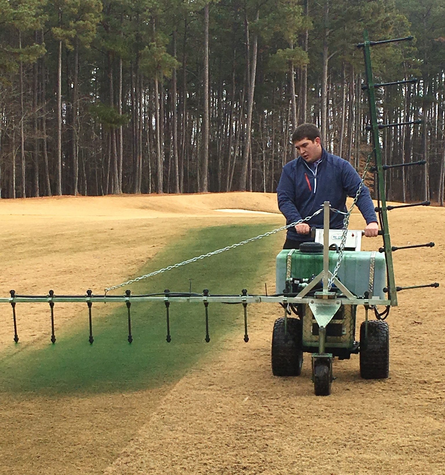 NC State Student managing turfgrass spray program