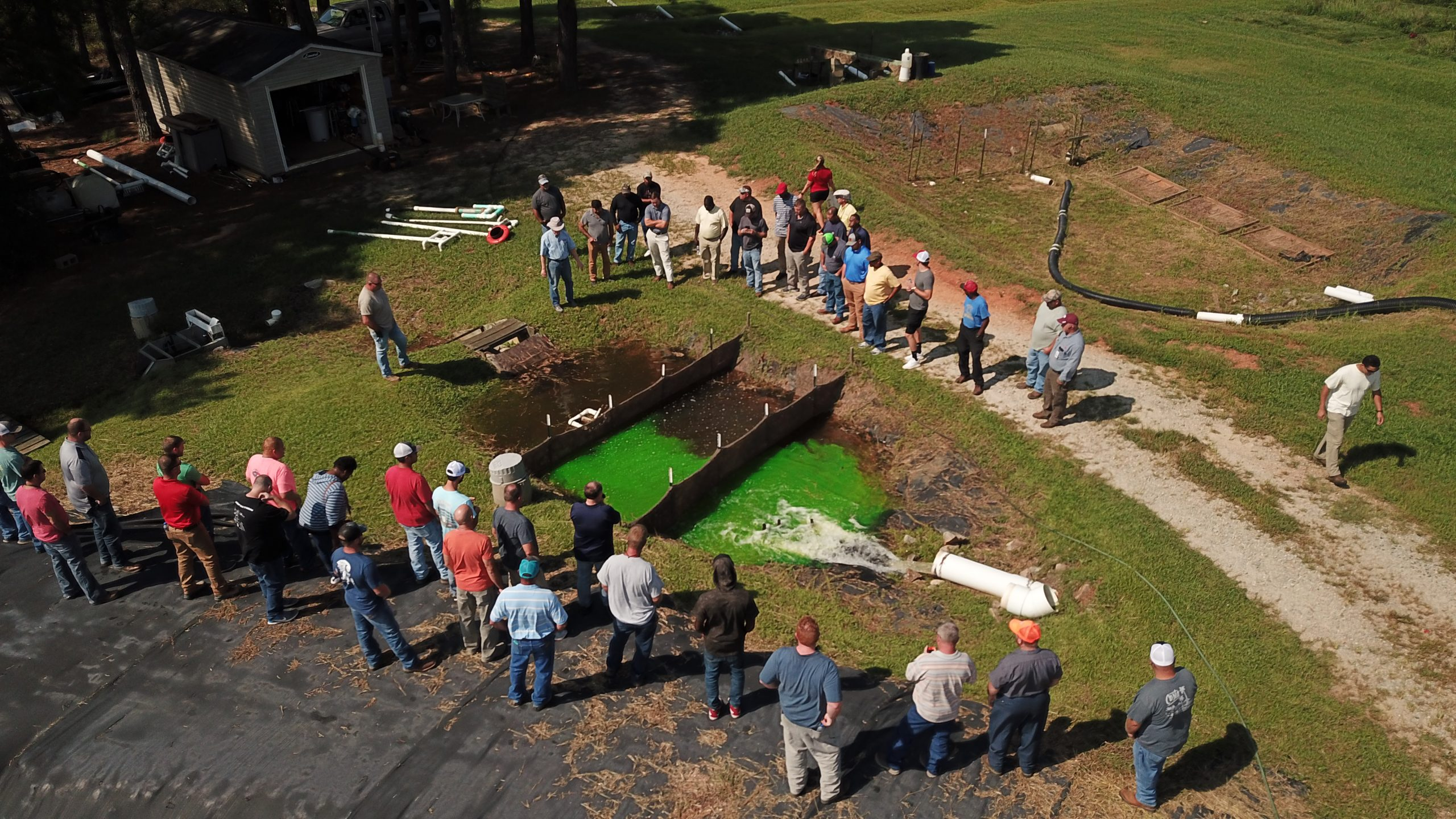 Group of soil students observe a sediment basin
