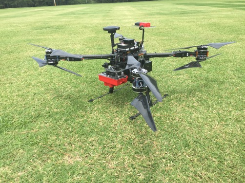 aerial drone resting on green grass