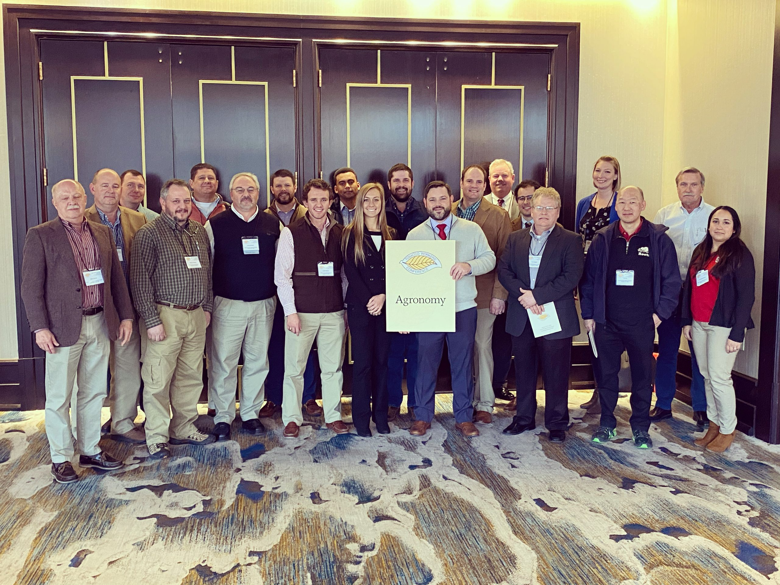 group of NC State researchers at tobacco workers conference
