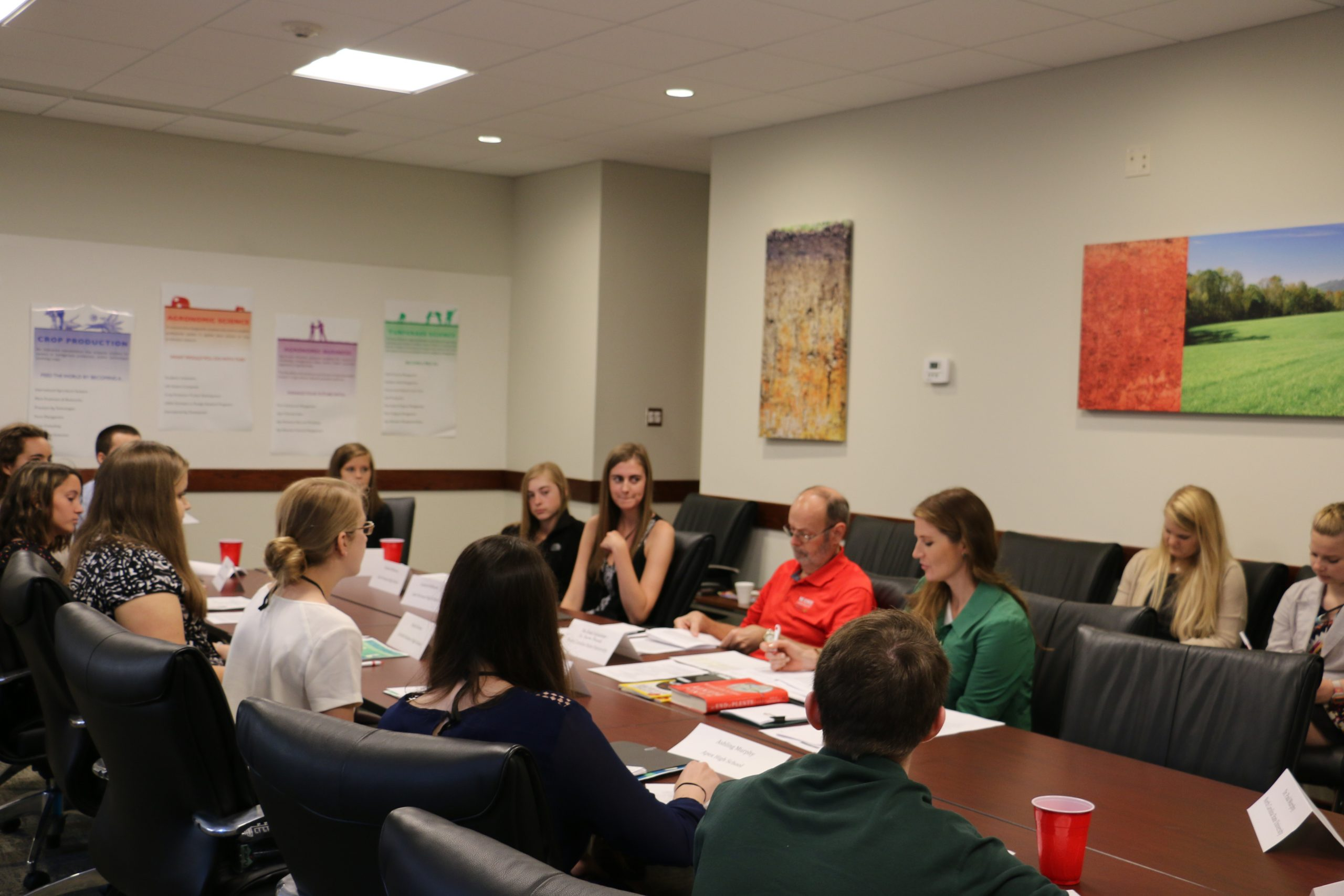 A large group of students seated around a conference table