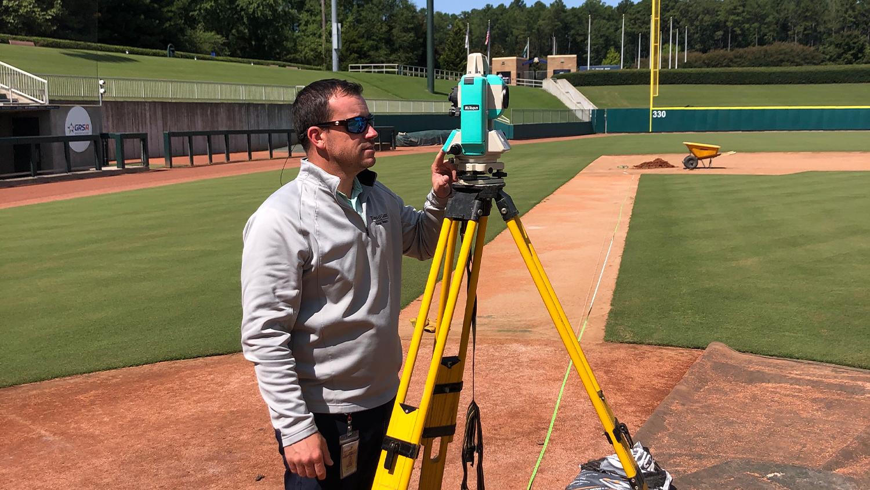 Man surveying baseball field