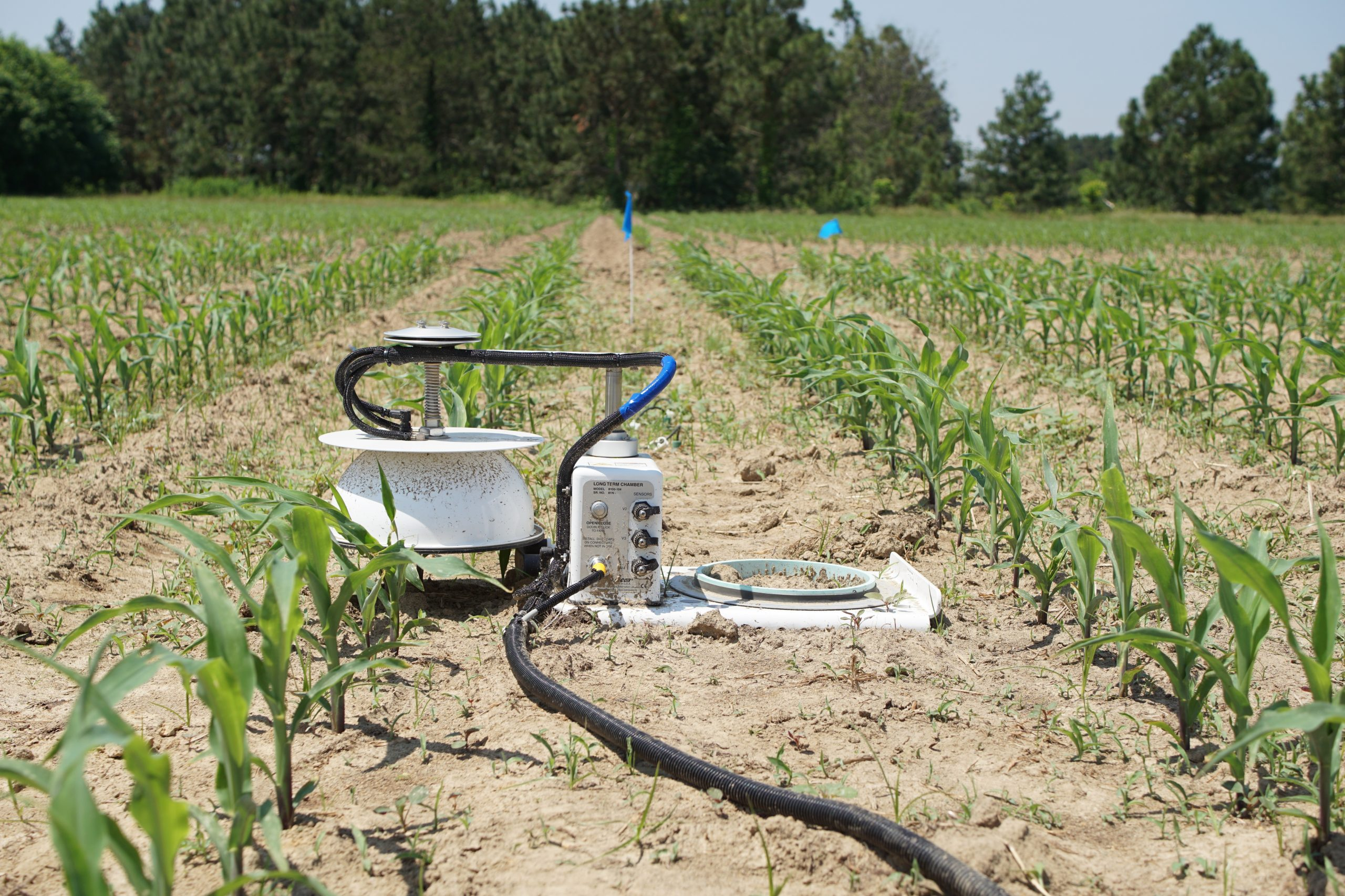 soil emissions device in a corn field