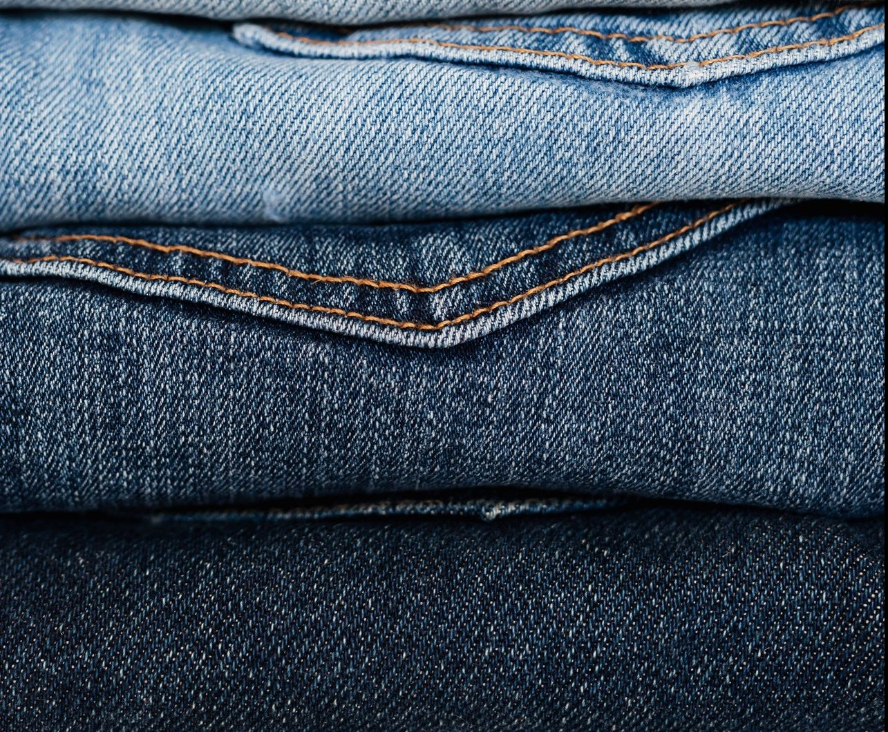 a pile of denim jeans