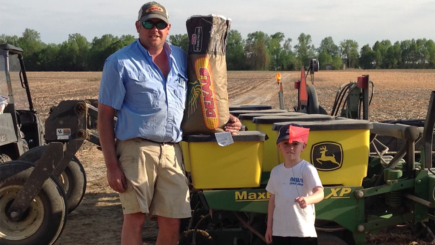 Man and young son prepare corn seed