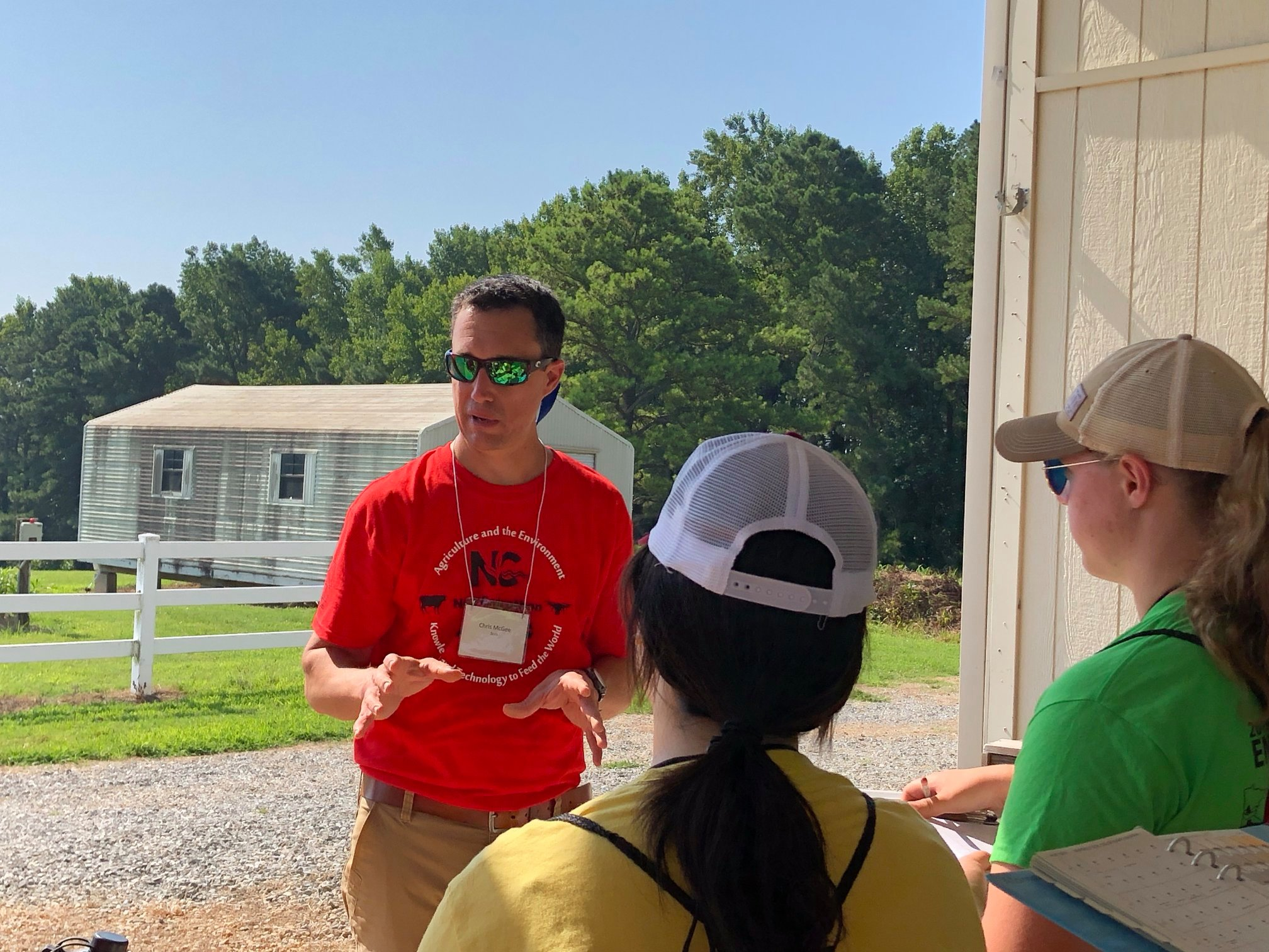 A soil scientist talking with Envirothon students