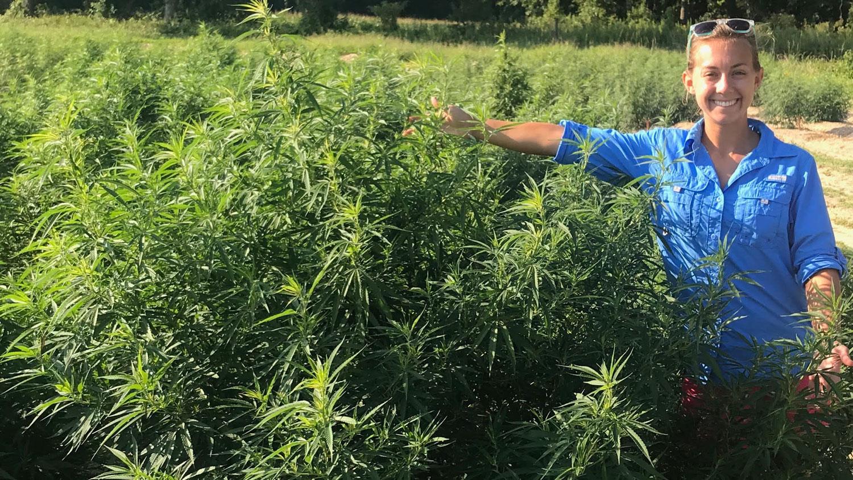 Maggie Short standing in a hemp field