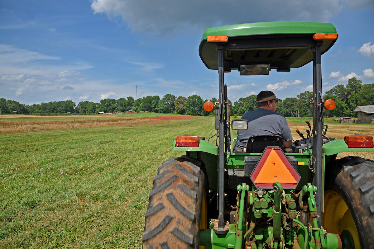 farmer drives to a field on a tractor in North Carolina