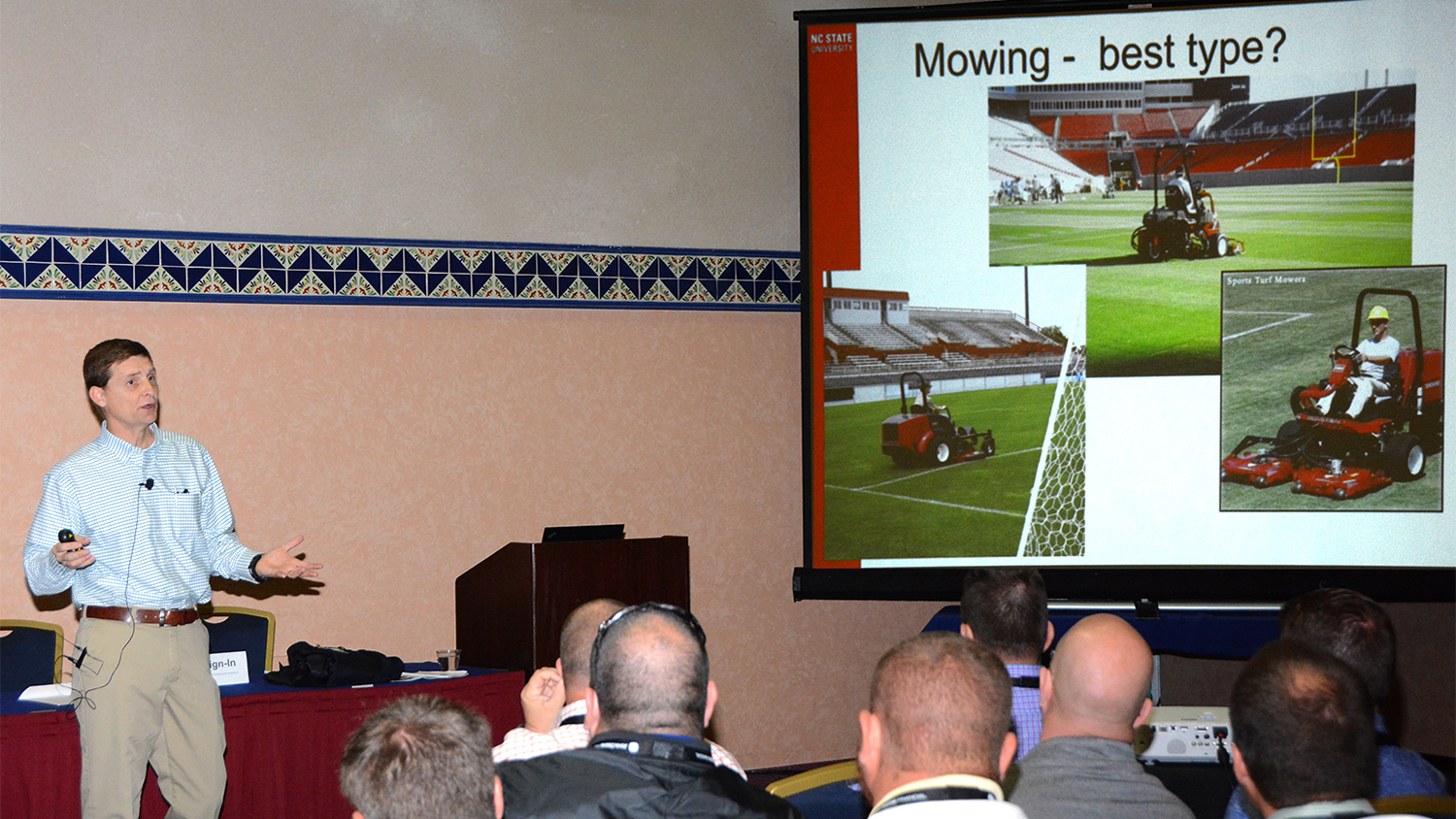 Grady Miller speaks to a group about sports turf mowing