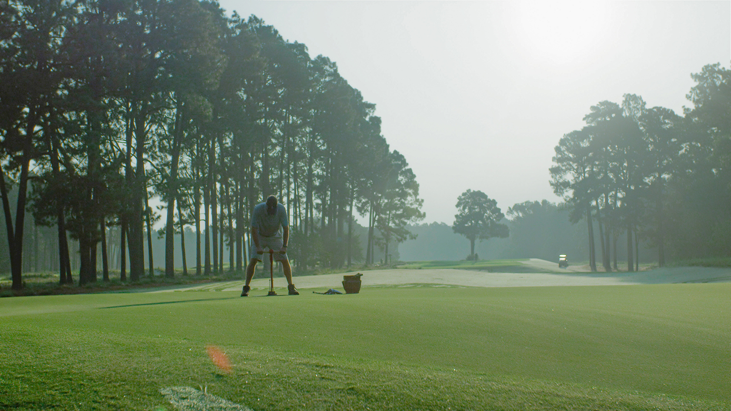 Cutting a golf course cup at Pinehurst No. 2