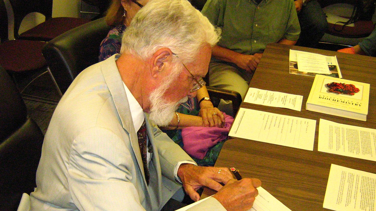 Dr. H. Robert Horton signs the agreement creating the new endowment.