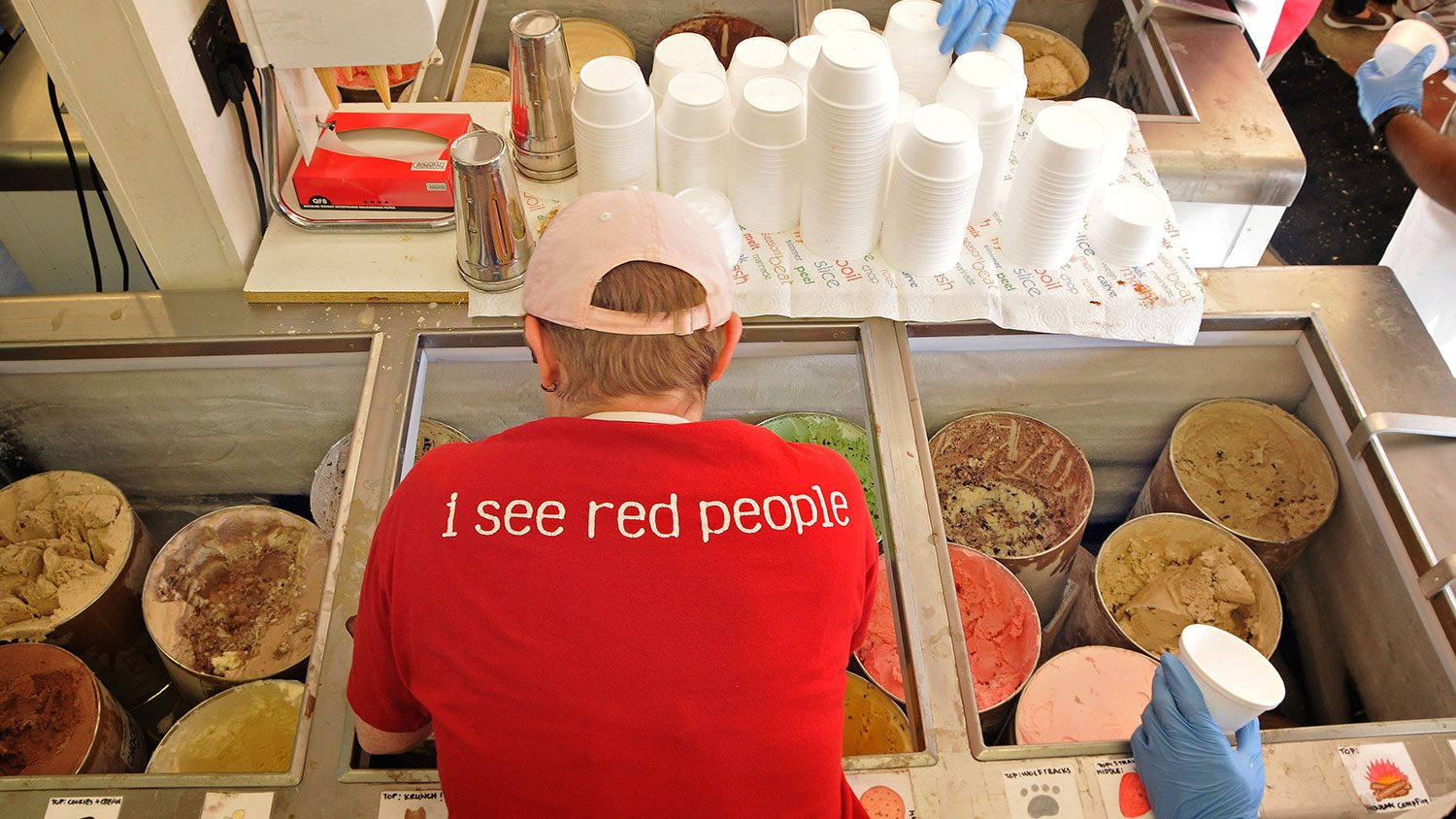 worker scoops Howling Cow ice cream