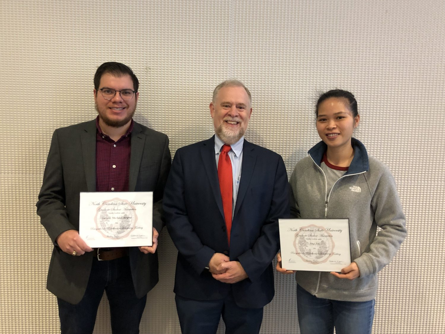 Steven Reyna and Jing Jin with the Dean of the Graduate School, Dr. Peter Harries