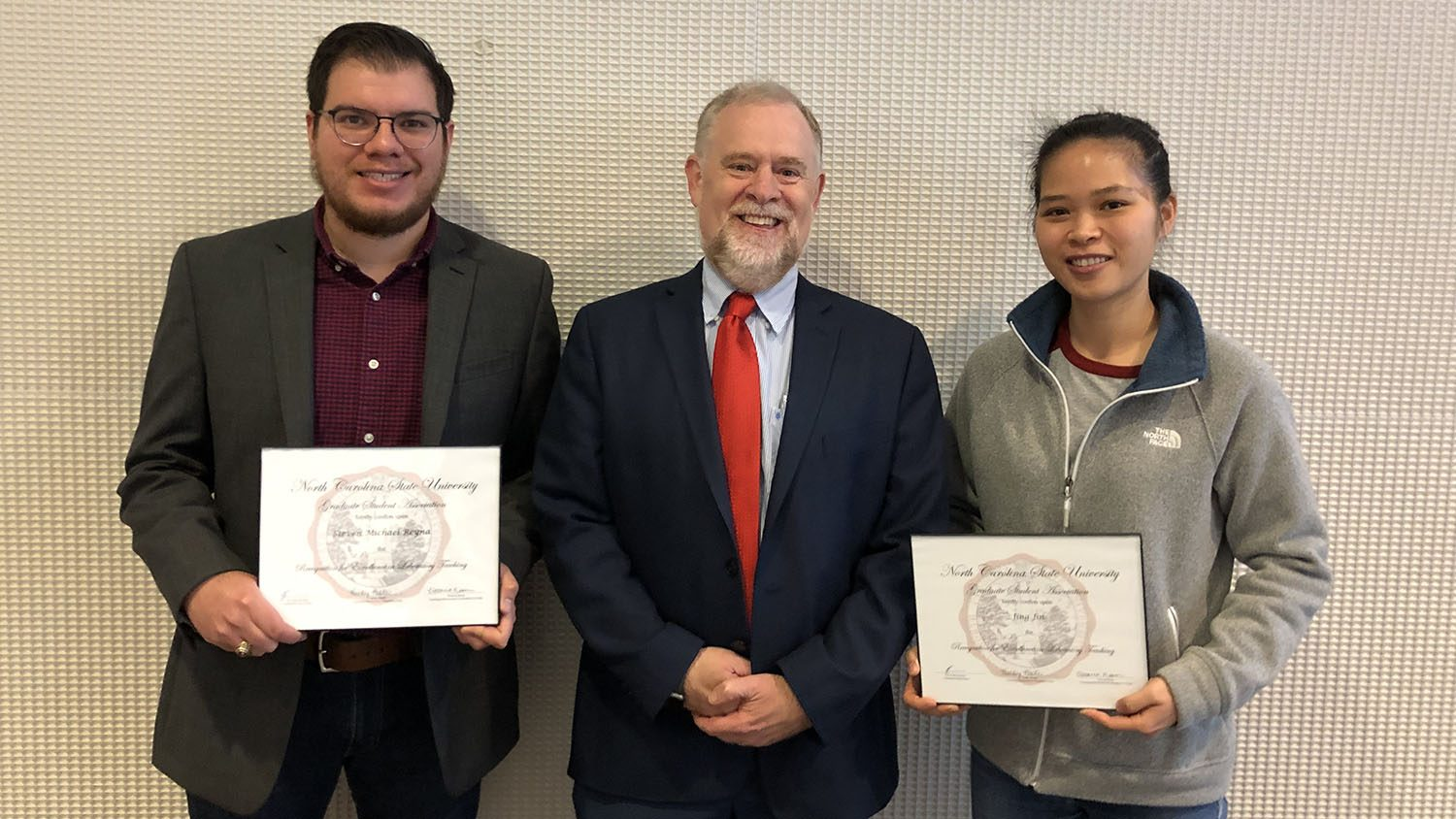 Steven Reyna and Jing Jin with the Dean of the Graduate School, Dr. Peter Harries after receiving Teaching Awards