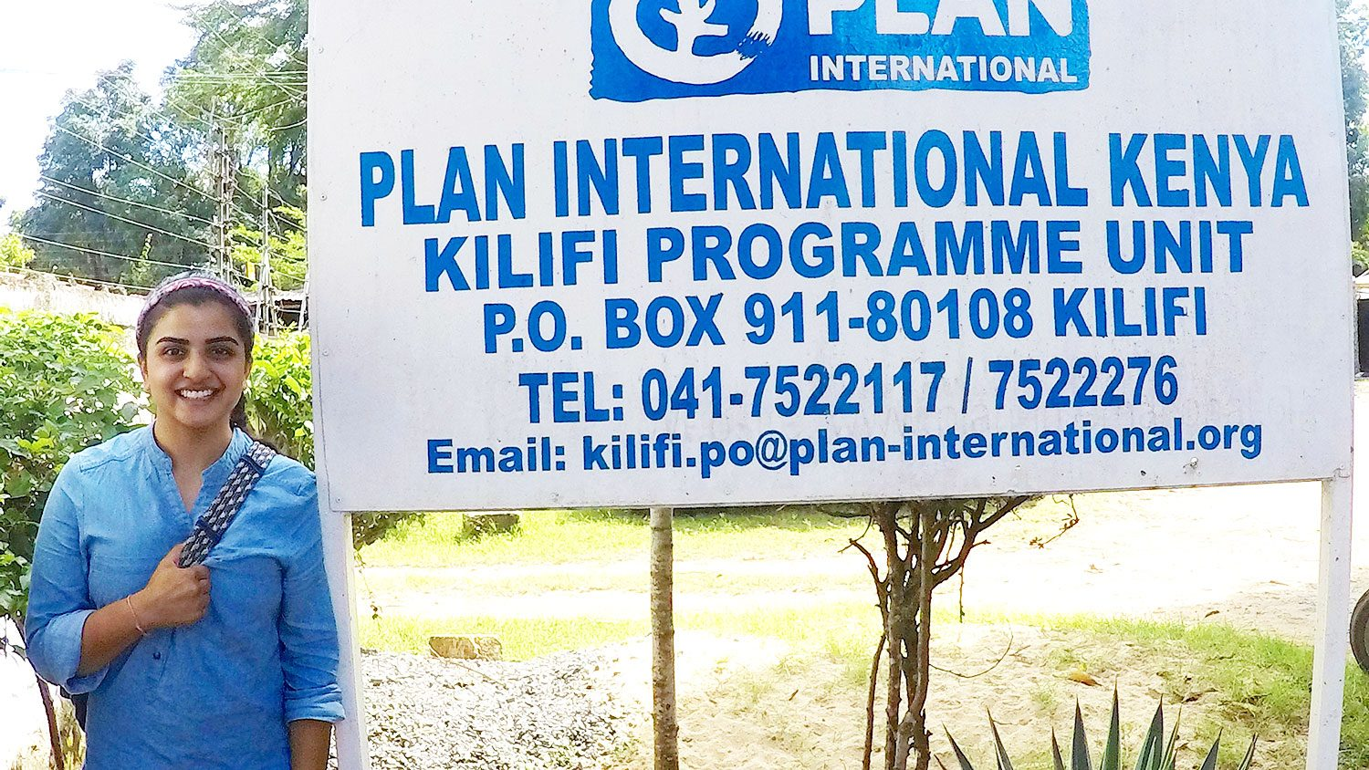 CALS grad student Krupa Trivedi standing in front of a Plant International sign