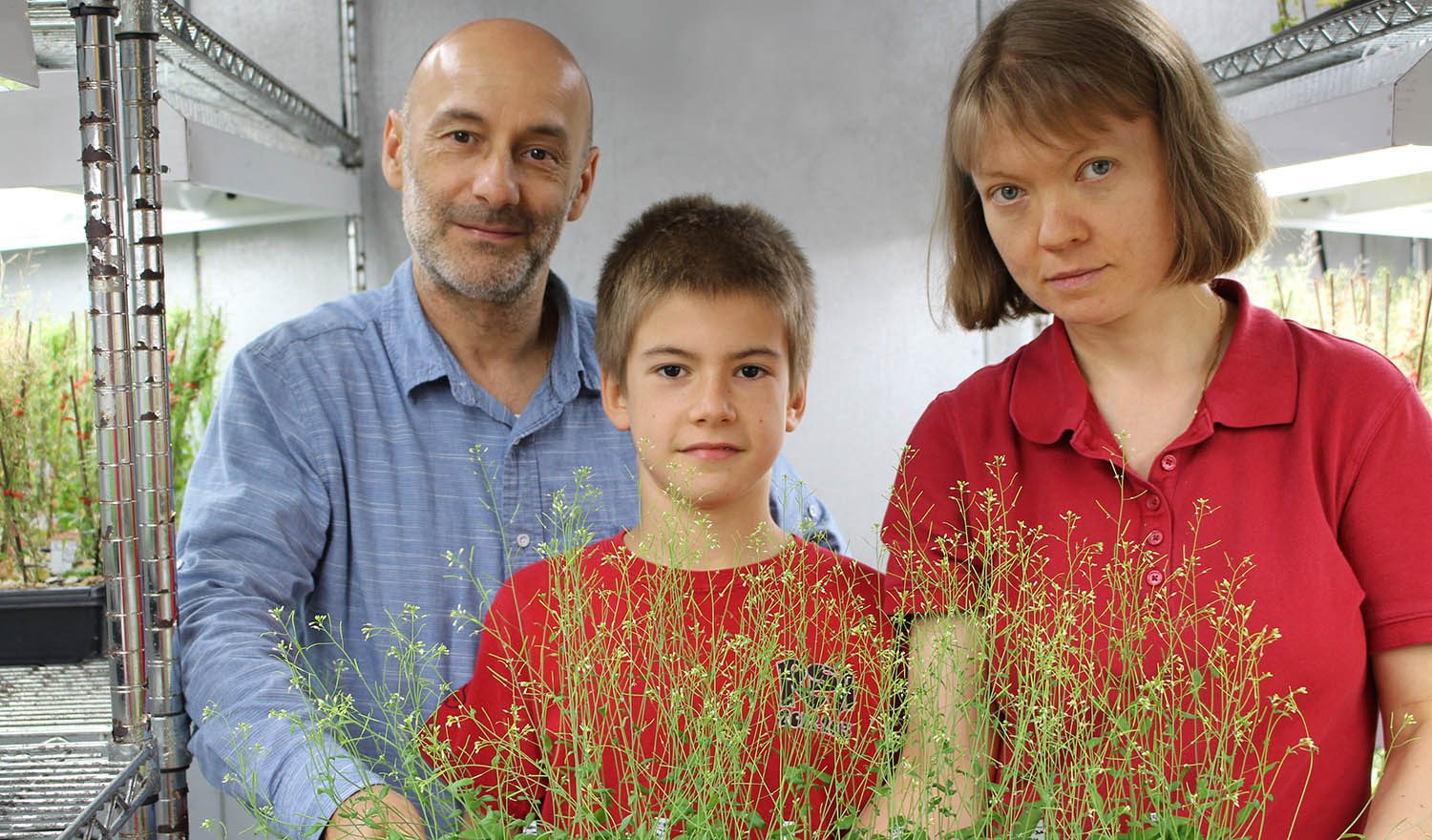 Antonio Alonso-Stepanov with his parents in their growth chamber at NC State.