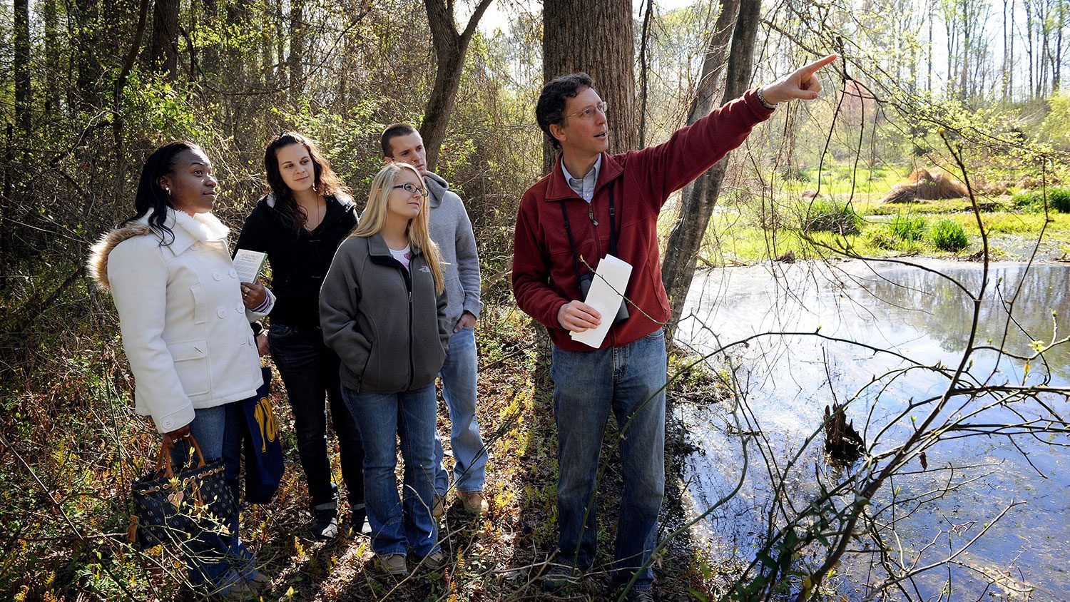 Nick Haddad in field with students