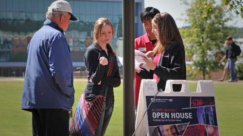 A perspective student asks directions at an open house