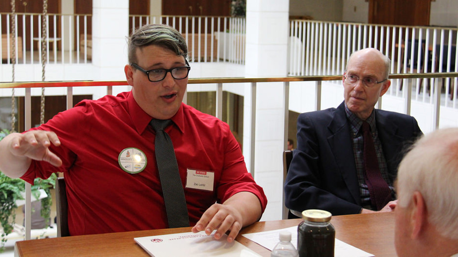 An enthusiastic Lentz gives Sen. John Alexander an overview of the potential of his research to solve one of North Carolina's difficult waste management problems.