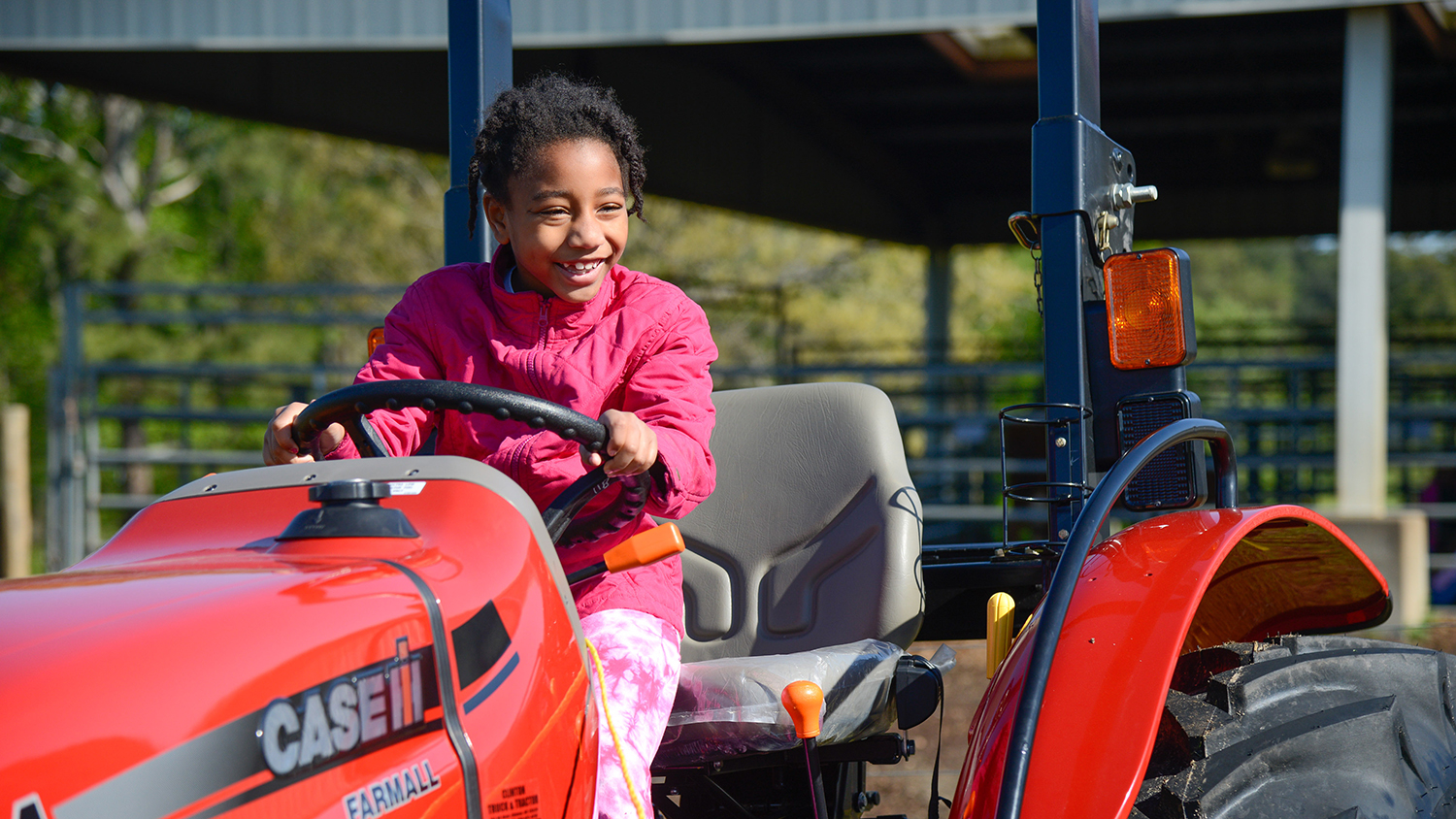 Little girl on tractor at CALS Farm Animal Days
