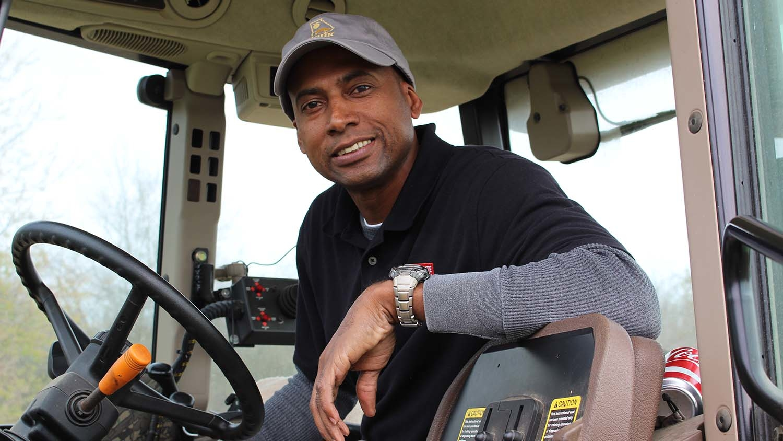 James Lamb in tractor cab.