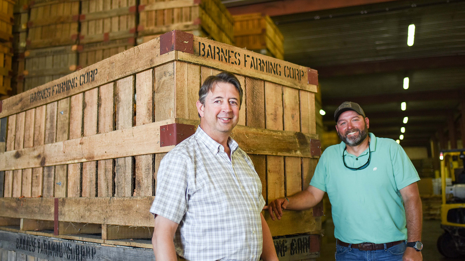 Johnny Barnes and Bryan Salmons in a facility where sweet potatoes are packaged for sale.