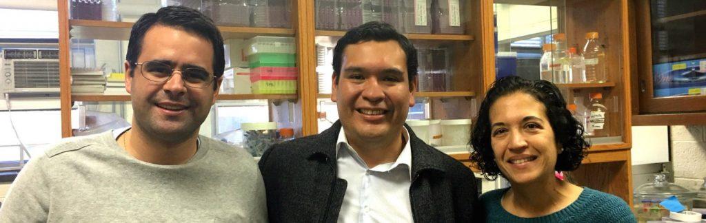 Dr. Eduardo Fuentes Universidad Agraria La Molina in Lima, Peru, with two faculty members on campus.